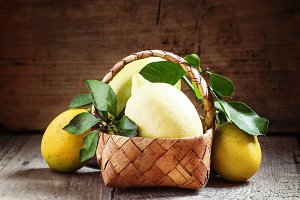 Fresh lemons with leaves in a wicker