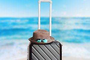 suitcase on wheels. on the beach for