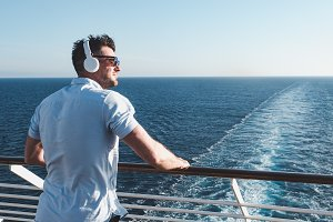 Man on the deck of a cruise ship