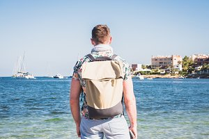 Traveler with backpack and mobile