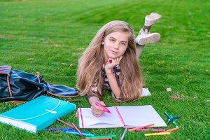 Student studying in park. Joyful hap