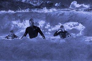 triathletes emerging in the beach