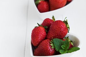 Bowls with fresh strawberries