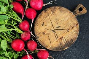 Bunch of radish with empty board