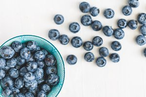 Bowl with fresh ripe blueberries