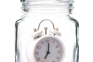 White Alarm clock in jar