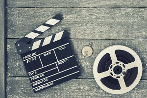 Clapperboard, movie reel and pocket