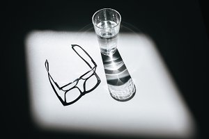 Close up photo of glasses and glass