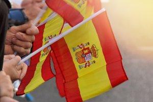 spain flags held by people
