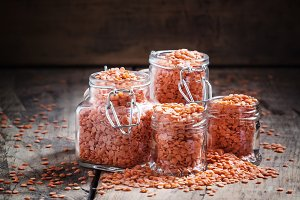 Useful red lentils in glass jars for