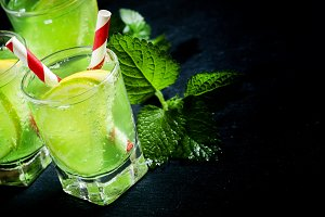 Green soft drink with lemon and lime