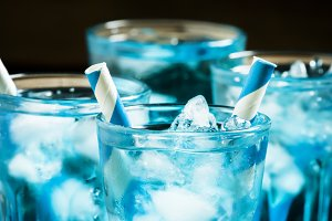 Blue cocktail with crushed ice on a