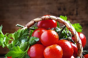 Cherry tomatoes and parsley in wicke