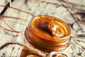 Soft homemade caramel in a glass jar