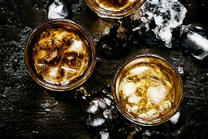 Cold whiskey in a glass with crushed