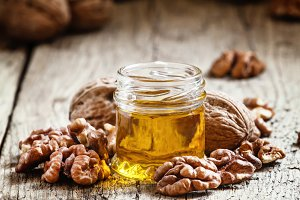 Walnut oil in a small jar and kernel