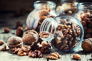 Walnuts in a glass jar, nut mix, ton