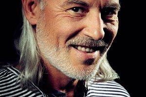 Smiling senior bearded man