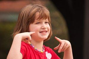 Adorable Girl Poses While Playing