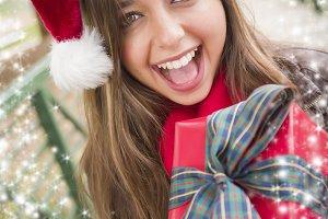 Pretty Woman Wearing a Santa Hat wit