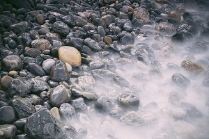 Pebbles and water on the sea shore