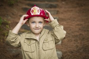 Adorable Child Boy with Fireman Hat