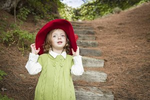 Adorable Child Girl with Red Hat Pla