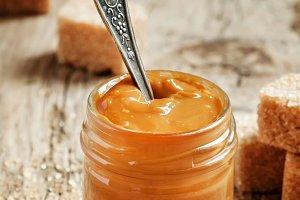 Sweet liquid caramel in a small jar