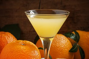 Yellow cocktail with orange juice in