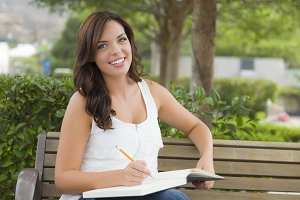 Young Adult Female Student on Bench