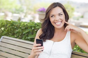 Smiling Young Adult Female Texting o