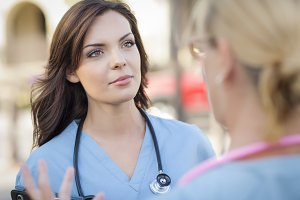 Two Young Adult Female Doctors or Nu