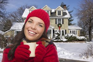 Smiling Woman in Winter Clothing Hol