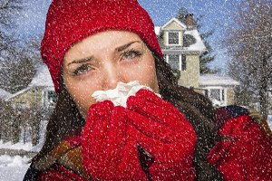 Sick Woman In Snow Blowing Her Sore