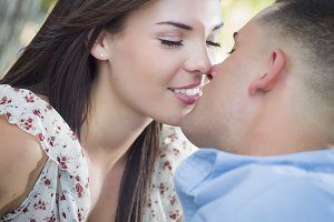 Mixed Race Romantic Couple Kissing i