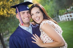 Male Graduate in Cap and Gown and Gi
