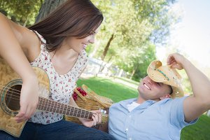 Mixed Race Couple with Guitar and Co