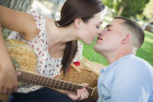 Mixed Race Couple with Guitar Kissin