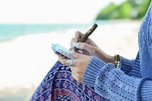 woman writing on beach
