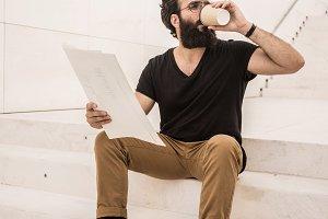 Man reads newspaper or magazine