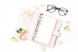 Planner with paperclips