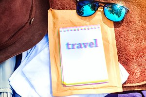 on notepad inscription travel. cloth