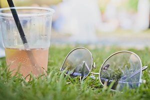 Sunglasses with Cocktail on Grass