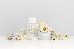 Cosmetics mockup with white flowers