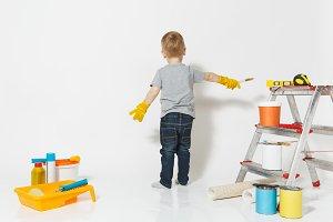 Little cute boy in yellow gloves wit
