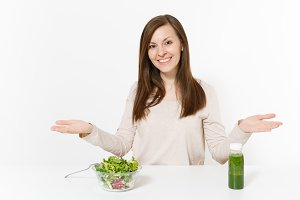 Woman spread hands at table with gre