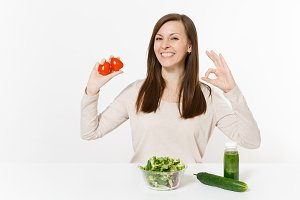 Woman at table with green detox smoo