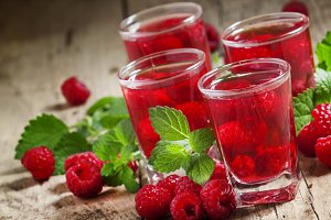 Refreshing raspberry drink with berr