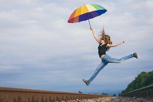 Teen girl with umbrella.