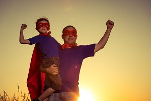 Father and son playing superhero.